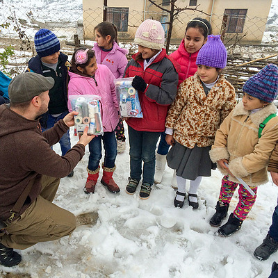 Handing out books to children