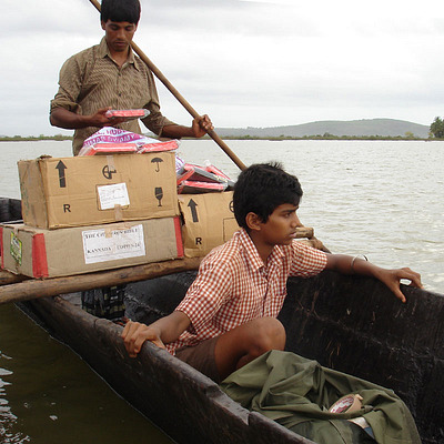 Two men in boat transporting bibles